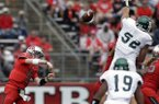 Eastern Michigan defensive lineman Pat O'Connor (52) leaps to block a pass by Rutgers quarterback Chas Dodd (19) during the first half of an NCAA college football game in Piscataway,N.J., Saturday, Sept. 14, 2013. Rutgers won 28-10. (AP Photo/Mel Evans)