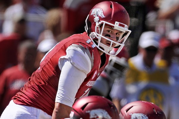 Arkansas quarterback AJ Derby prepares to take a snap in the second half of the game against Southern Miss on Saturday September 14, 2013 at Razorbacks Stadium in Fayetteville.
