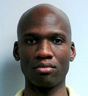 This image released by the FBI shows a photo of Aaron Alexis, who police believe was a gunman at the Washington Navy Yard shooting in Washington on Monday morning, Sept. 16, 2013, and who was killed after he fired on a police officer.