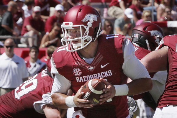 In this photo taken Sept. 14, 2013, Arkansas backup quarterback AJ Derby prepares to hand off during the third quarter of an NCAA college football game against Southern Mississippi in Fayetteville, Ark. Derby may start against Rutgers depending on injured Brandon Allen's condition. (AP Photo/Danny Johnston)