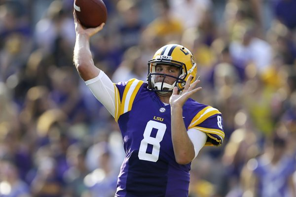 LSU quarterback Zach Mettenberger (8) warms up before an NCAA college football game against Kent State in Baton Rouge, La., Saturday, Sept. 14, 2013. (AP Photo/Gerald Herbert)