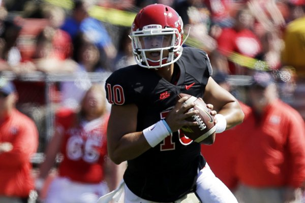 In this April 27, 2013, file photo, Rutgers quarterback Gary Nova looks to pass during the first half of Rutgers' spring NCAA college football game in Piscataway, N.J.
