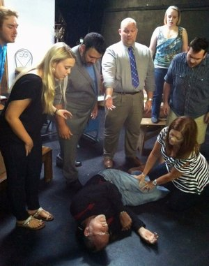 Amateurs actors (clockwise from top left) Trent Reese, Haley Martin, Chris Harris, Jeff Ward, Elizabeth Williams, Jake Whisenant, Wendy Shirar (kneeling) and Len Schlientz (on floor).