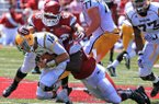 Arkansas defensive ends Trey Flowers (86) and Chris Smith (42) sack Southern Miss quarterback Allan Bridgford at Reynolds Razorback Stadium in Fayetteville.