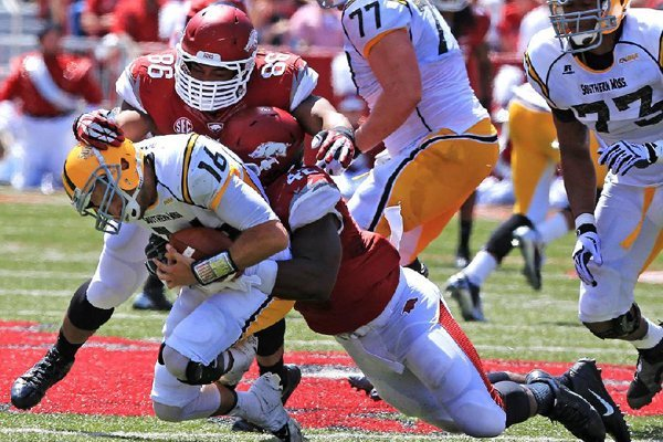 arkansas-defensive-ends-trey-flowers-86-and-chris-smith-42-sack-southern-miss-quarterback-allan-bridgford-at-reynolds-razorback-stadium-in-fayetteville