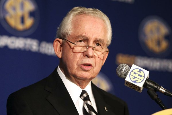FILE - In this July 21, 2010, file photo, Southeastern Conference commissioner Mike Slive talks at a news conference during the SEC Media Days  in Hoover, Ala.   (AP Photo/ Butch Dill, File)