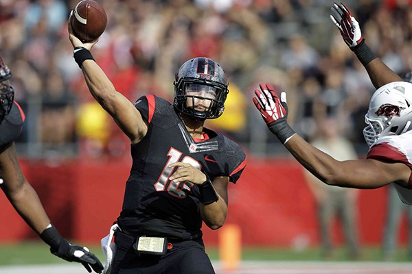 Rutgers quarterback Gary Nova, center, throws a pass during the first half of an NCAA college football game against Arkansas in Piscataway, N.J., Saturday, Sept. 21, 2013. (AP Photo/Mel Evans)