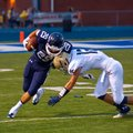#29 Jonathan Clemons of Greenwood turns up field #12 Alan King of Shiloh brings him down.