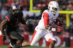 Arkansas running back Alex Collins runs away from Rutgers' Steve Longa in the 3rd quarter during their game Saturday at High Points Solutions Stadium in Pisctaway, N.J.