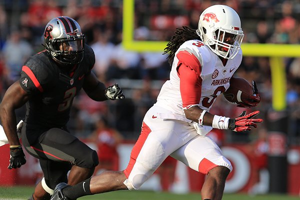 arkansas-running-back-alex-collins-runs-away-from-rutgers-steve-longa-in-the-3rd-quarter-during-their-game-saturday-at-high-points-solutions-stadium-in-pisctaway-nj