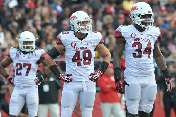 Arkansas defenders (left to right) Alan Turner, Austin Jones and Braylon Mitchell look to the sidelines during the Razorbacks' game against Rutgers at High Point Solutions Stadium in Piscataway, New Jersey.