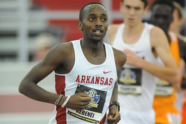 Arkansas junior Stanley Kebenei, left, leads Florida senior Mark Parrish, right, in the 5,000 meters final Sunday, Feb. 24, 2013, during the Southeastern Conference Indoor Track and Field Championships at the Randal Tyson Track Center in Fayetteville.
