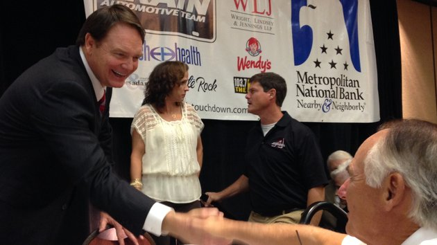 former-arkansas-coach-houston-nutt-greets-fans-after-his-address-of-the-little-rock-touchdown-club-on-monday-afternoon