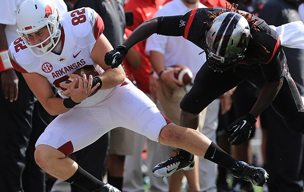 Arkansas' Alan D'Appollonio is tackled after he caught a pass for a first down on a fake punt during a game against Rutgers on Saturday, Sept. 21, 2013 at High Points Solutions Stadium in Pisctaway, N.J.