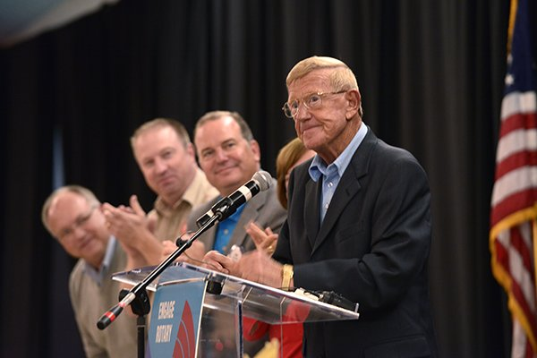 Former Arkansas/Notre Dame coach Lou Holtz waits for the applause to die down while serving as the guest speaker Monday Sept. 23, 2013 at the Springdale RotaryClub and NWA Touchdown Club luncheon at the Springdale Holiday Inn in Springdale. Holtz told stories from his coaching and broadcasting careers and some of the his opinions on the sport today.