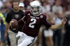 Texas A&M quarterback Johnny Manziel (2) rushes for a gain against Alabama during the first quarter of an NCAA college football game Saturday, Sept. 14, 2013 in College Station, Texas. (AP Photo/David J. Phillip)