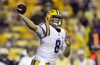 LSU quarterback Zach Mettenberger passes in the second half of an NCAA college football game against Auburn in Baton Rouge, La., Saturday, Sept. 21, 2013. LSU won 35-21. (AP Photo/Gerald Herbert)