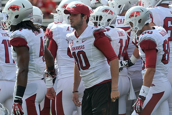 Arkansas quarterback Brandon Allen works with his team before the start of the Razorbacks game against the Rutgers Scarlet Knights at High Point Solutions Stadium in Piscataway, N.J.