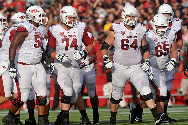 Arkansas offensive linemen (left to right) Grady Ollison, Brey Cook, Travis Swanson, Mitch Smothers and David Hurd break from the huddle during the Razorbacks' game against the Rutgers Scarlet Knights at High Point Solutions Stadium in Piscataway, N.J.