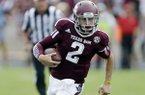 Texas A&M's Johnny Manziel (2) scrambles for yards during the third quarter of an NCAA college football game against Rice, Saturday, Aug. 31, 2013, in College Station, Texas. (AP Photo/Eric Gay)