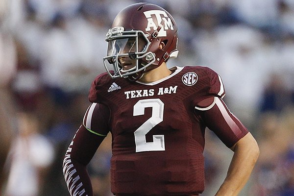 Texas A&M quarterback Johnny Manziel (2) stands with his hands on his hips after a penalty was called on Texas A&M during the second quarter of an NCAA college football game against SMU Saturday, Sept. 21, 2013, in College Station, Texas. (AP Photo/Bob Levey)