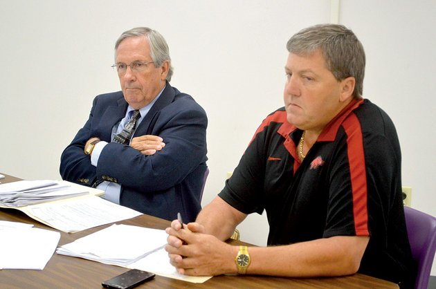 attorney-randy-coleman-left-and-jeff-cagle-former-mayflower-high-school-principal-listen-as-superintendent-john-gray-and-the-districts-attorney-bill-brazil-of-conway-talk-the-school-board-after-a-47-minute-executive-session-voted-unanimously-to-uphold-grays-recommendation-to-fire-cagle