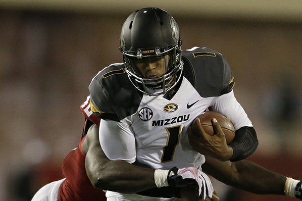 Missouri's James Franklin (1) runs ...