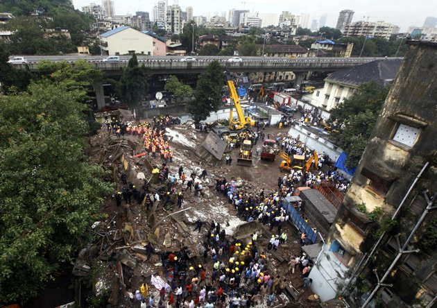indian-fire-officials-look-for-survivors-from-debris-of-a-collapsed-building-in-mumbai-india-on-friday-sept-27-2013