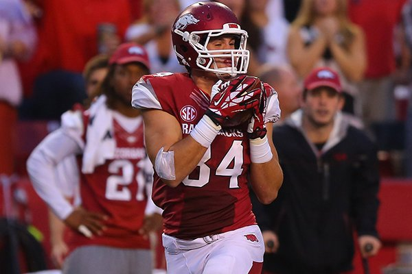 Arkansas tight end Hunter Henry hauls in a pass for a 52- yard gain late in the first quarter of Saturday's game against Texas A&M at Donald W. Reynolds Razorback Stadium in Fayettville.