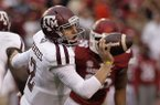 Texas A&M quarterback Johnny Manziel (2) tosses the ball during the first quarter of an NCAA college football game against Arkansas in Fayetteville, Ark., Saturday, Sept. 28, 2013. (AP Photo/Danny Johnston)