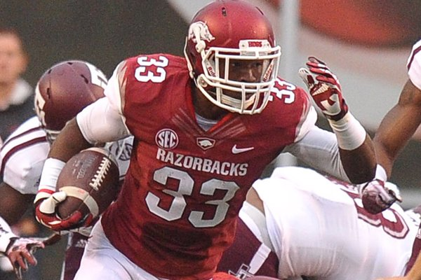 Arkansas freshman Korliss Marshall returns a kick for a big gain against Texas A&M Saturday at Donald W. Reynolds Razorback Stadium.