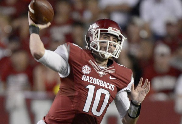 Arkansas quarterback Brandon Allen throws ...