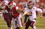 Texas A&M's Johnny Manziel tries to run during their last drive in the second quarter during their game Saturday at Donald W. Reynolds Razorback Stadium in Fayettville, Ark.