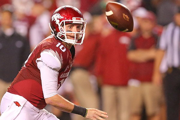 Arkansas Razorbacks' Brandon Allen pitches the ball to Alex Collins during their game against Texas A&M Saturday at Donald W. Reynolds Razorback Stadium in Fayettville, Ark.