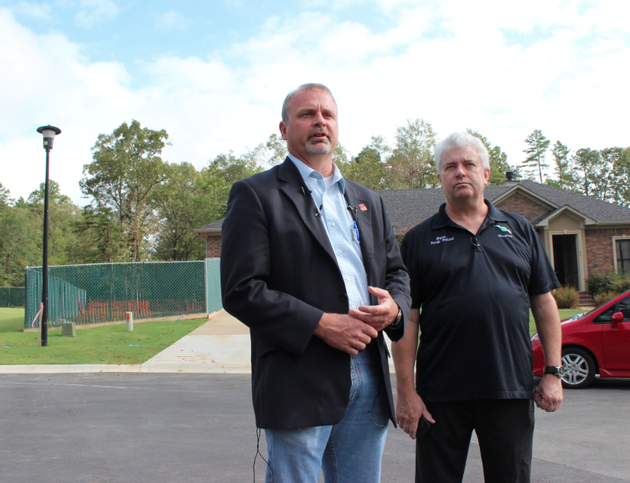 faulkner-county-judge-allen-dodson-left-and-mayflower-mayor-randy-holland-speak-monday-in-front-of-the-site-where-oil-spilled-from-a-pipeline-in-mayflower-about-six-months-ago-the-rupture-site-to-the-left-of-the-home-has-been-fenced-off