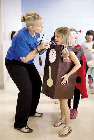 "DeLanna Lacy, principal of Ellen Smith Elementary School, talks to Haven Sellers, 5, last week during the kindergarten nursery-rhyme parade. Haven was dressed to represent ""Hickory Dickory Dock."" Ellen Smith was named as a 2013 National Blue Ribbon School."