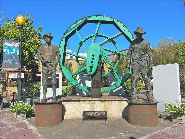 oil-heritage-park-in-downtown-el-dorado-features-a-12-foot-tall-band-wheel-from-the-boom-years-of-the-1920s-the-sculpture-honors-the-friendship-between-petroleum-magnates-charles-murphy-and-chesley-pruet