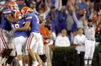 Florida kicker Caleb Sturgis (19) is congratulated by teammates after kicking a field goal late in the fourth quarter against Arkansas on Saturday, Oct. 17, 2009 at Ben Hill Griffin Stadium in Gainesville, Fla. The score was the game-winner, making it 23-20.
