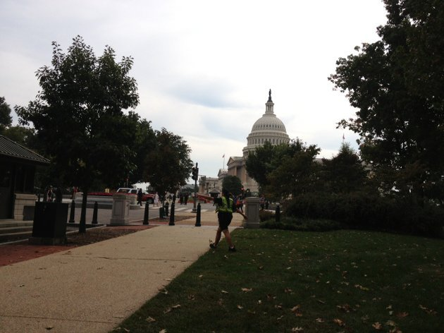 a-police-officer-walks-near-the-capitol-after-a-shootout-that-occurred-on-thursday-oct-3-2013