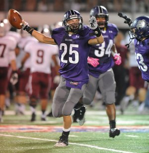 Fayetteville's Jake Hornibrook (25) celebrates an interception during the first half against Springdale Friday, Oct. 4, 2013, at Harmon Stadium in Fayetteville.