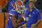 Florida defensive back Loucheiz Purifoy (15) runs for a 42-yard touchdown after intercepting an Arkansas pass during the first half of an NCAA college football game in Gainesville, Fla., Saturday, Oct. 5, 2013.(AP Photo/John Raoux)