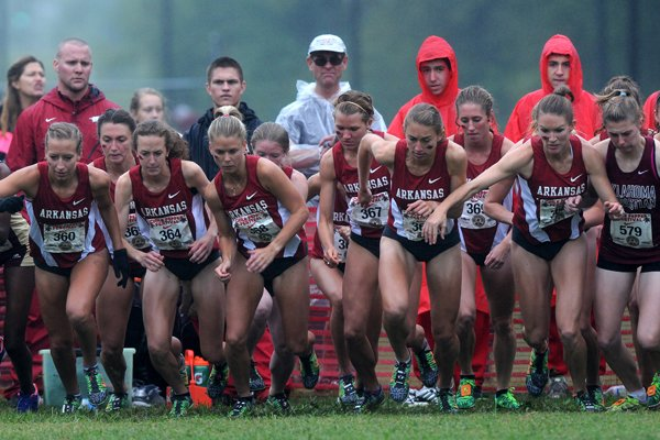 The Arkansas women's cross country team takes off at the start of the 25th annual Chile Pepper Cross County Festival Saturday, Oct. 5, 2013, at the University of Arkansas Cross County course located on the UA Agriculture Farm in Fayetteville. Lightning delayed the races by more than an hour and caused the 10K Open race to be cancelled.