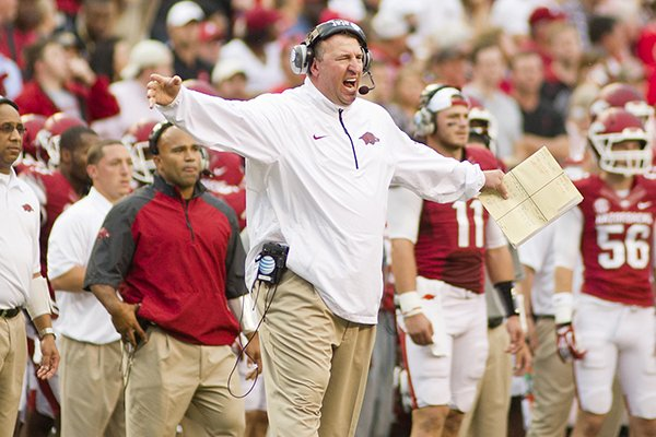 Arkansas Razorback head coach Bret Bielema reacts to a call during an NCAA college football game against Texas A&M in Fayetteville, Ark., Saturday, Sept. 28, 2013. (AP Photo/Beth Hall)