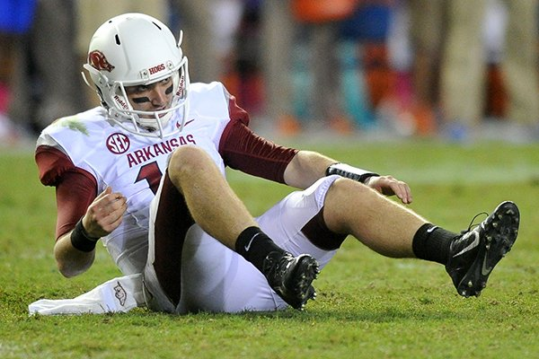 Arkansas quarterback Brandon Allen gets back up after being knocked down in the 4th quarter of Saturday night's game at Ben Hill Griffin Stadium in Gainesville, Fla.