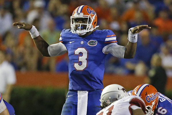 Florida quarterback Tyler Murphy (3) calls a play at the line of scrimmage during the second half of an NCAA college football game against Arkansas in Gainesville, Fla., Saturday, Oct. 5, 2013.(AP Photo/John Raoux)