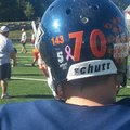 PHOTO-PAUL BOYD-The Rogers Heritage football team sports an orange 143 sticker on the back of each h...