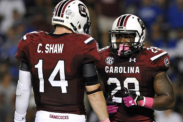 South Carolina running back Mike Davis (28) celebrates his touchdown with Connor Shaw (14) during the first half of an NCAA college football game against Kentucky, Saturday, Oct. 5, 2013, in Columbia, S.C. (AP Photo/Rainier Ehrhardt)