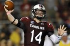 South Carolina quarterback Connor Shaw throws during the first half of an NCAA college football game against Kentucky, Saturday, Oct. 5, 2013, in Columbia, S.C. (AP Photo/Rainier Ehrhardt)