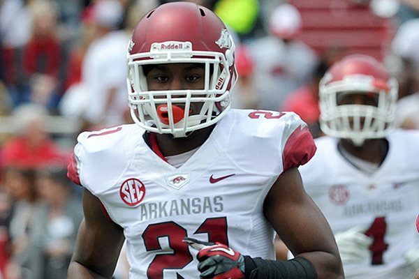 Arkansas cornerback Carroll Washington runs onto the field prior to the Red-White Game on April 20, 2013 at Razorback Stadium in Fayetteville.