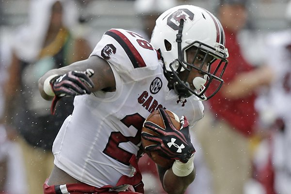 South Carolina running back Mike Davis runs for yardage against Central Florida during the second half of an NCAA college football game in Orlando, Fla., Saturday, Sept. 28, 2013. South Carolina won the game 28-25.(AP Photo/John Raoux)